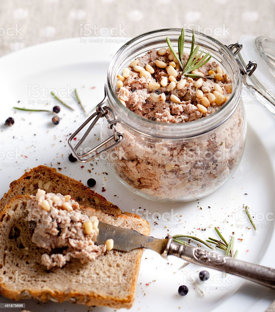 Duck meat terrine, pate with pine nuts, rosemary stock photo