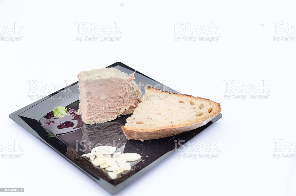 Duck pate with sauce of black berries and cranberries stock photo
