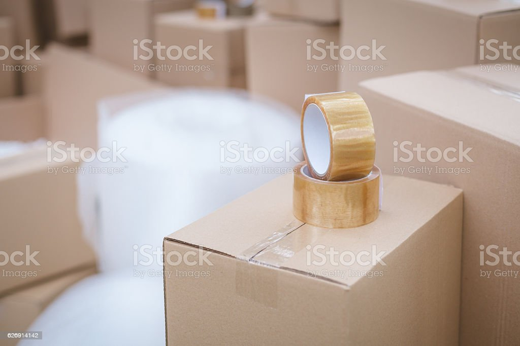 duct tape on cardboard box stock photo