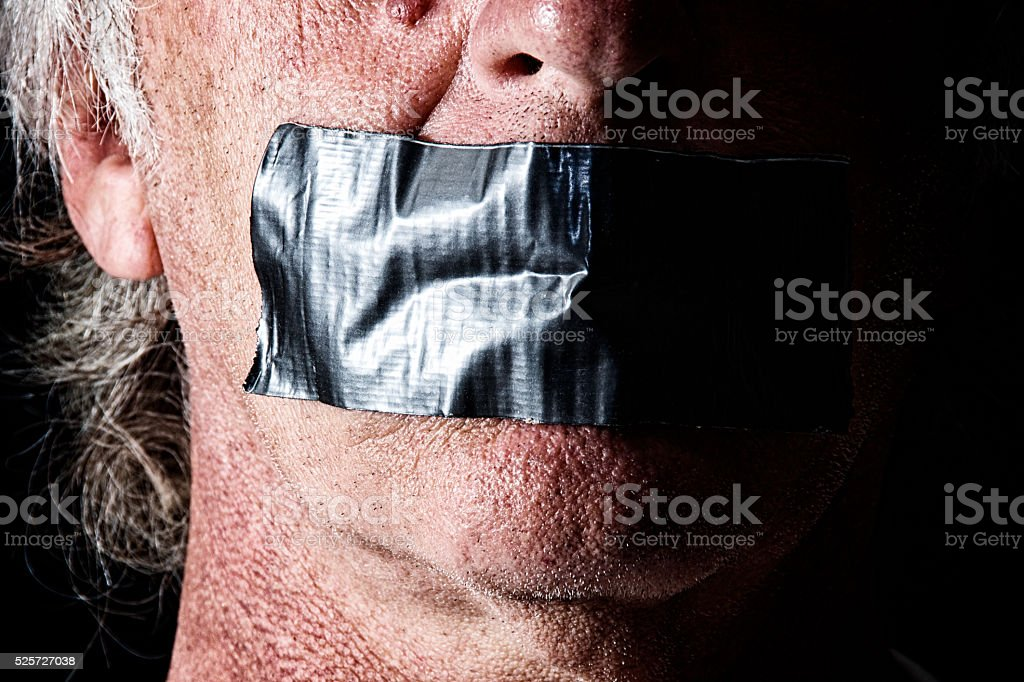 duct taped mouth close up stock photo