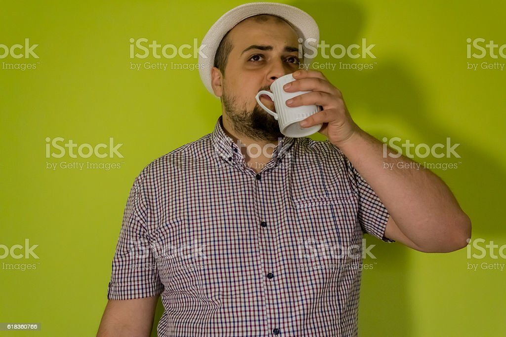 Dude drinking from a cup stock photo