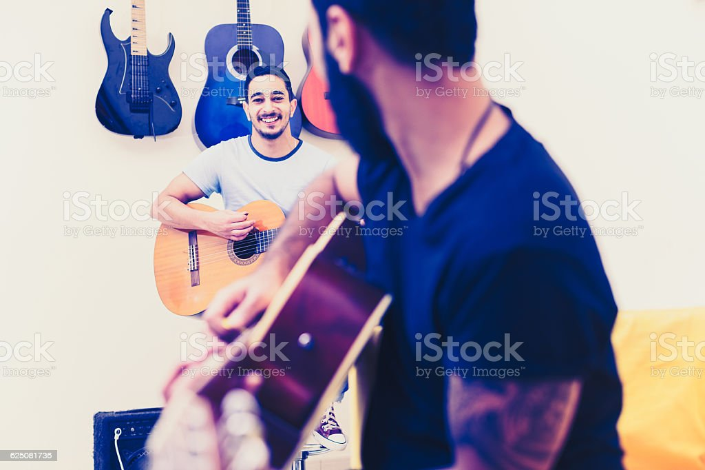 Dude, see if this riff is good enough! stock photo