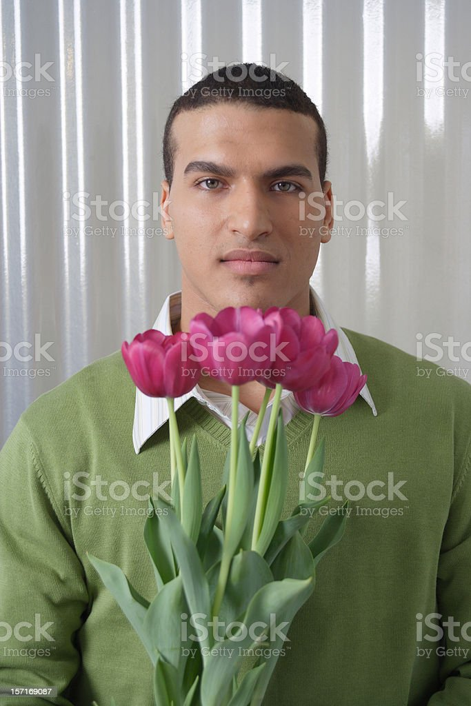 Dude with pink tulips stock photo