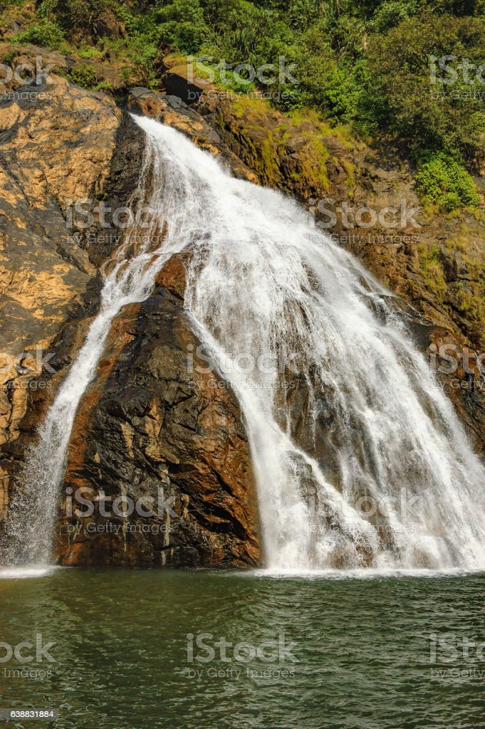 Dudhsagar Waterfall in tropical jungle of India stock photo