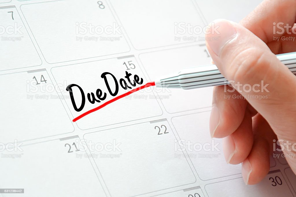 Due Date text on the calendar underlined with red marker stock photo
