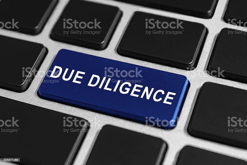 due diligence button on keyboard stock photo