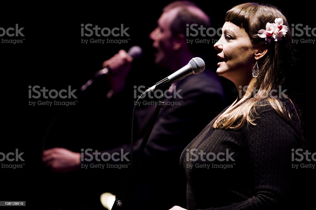 Duet between a male and female vocalist live on stage stock photo