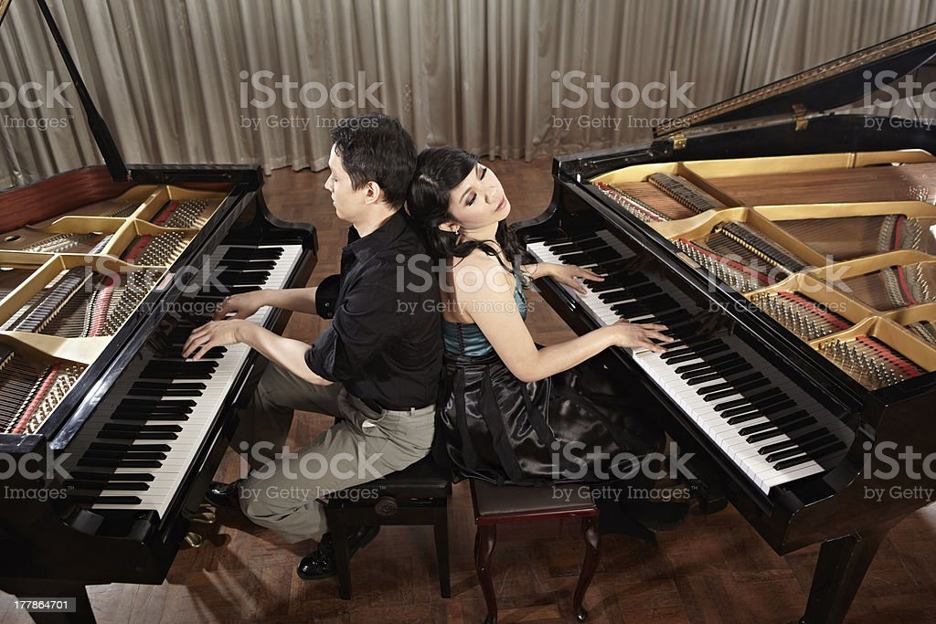 Duet with pianos royalty-free stock photo