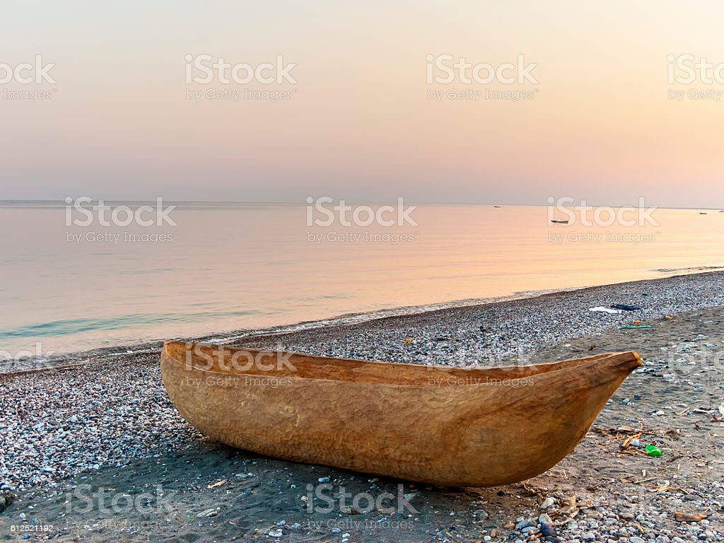 dug out longboat at the beach of lake Malawi stock photo