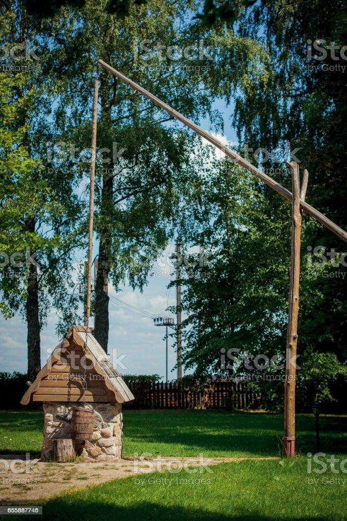A dug well, large shadoof (well sweep) in Bareikiskes, Lithuania stock photo