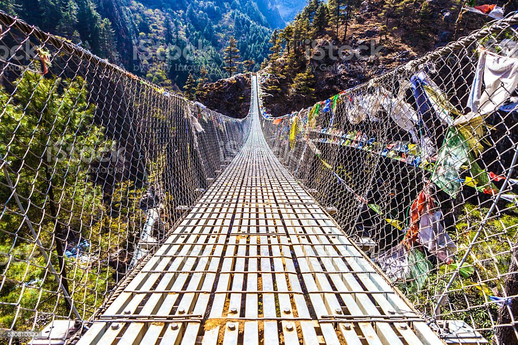 Dughla Waterfall Bridge in the Lobuche Valley, Nepal stock photo