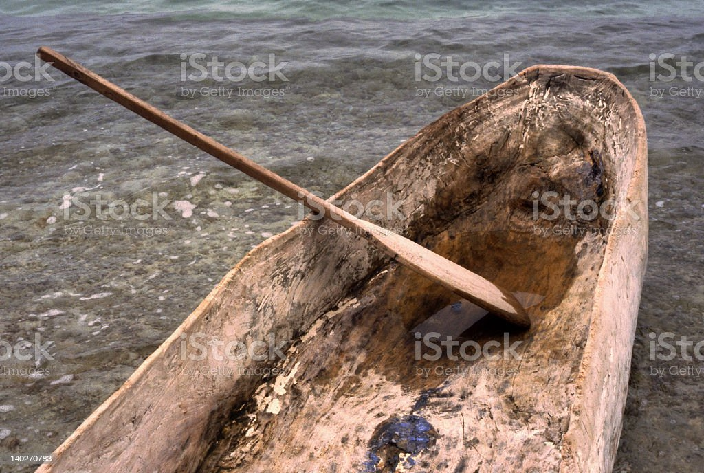 Dugout Log Wooden Canoe with Paddle - Haiti, West Indies royalty-free stock photo