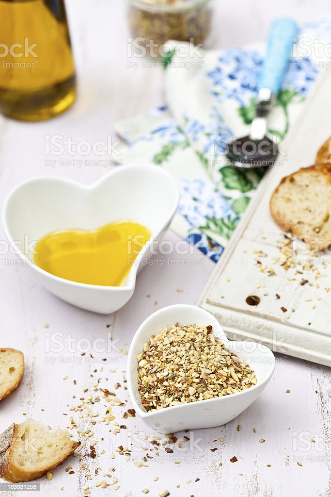 Dukkah with bread and olive oil in heart shaped bowls royalty-free stock photo