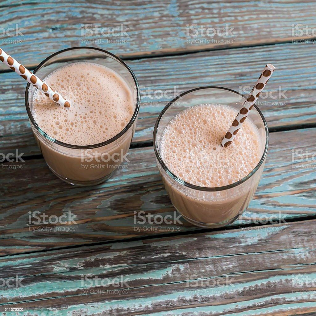 Dulce di leche and ice cream milkshake in glasses stock photo