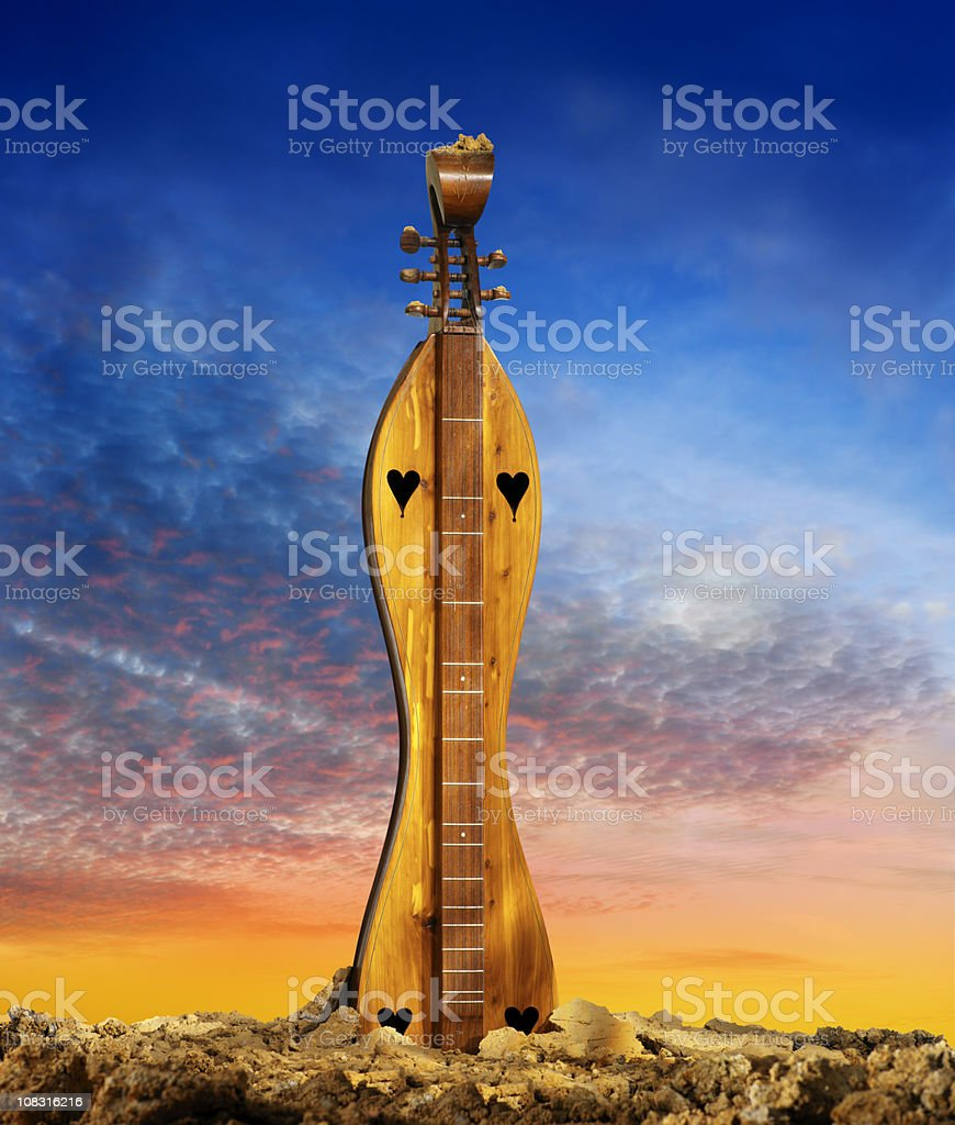 Dulcimer growing out of the earth stock photo
