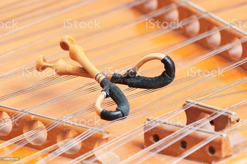 dulcimer stringed musical instrument with hammer stock photo