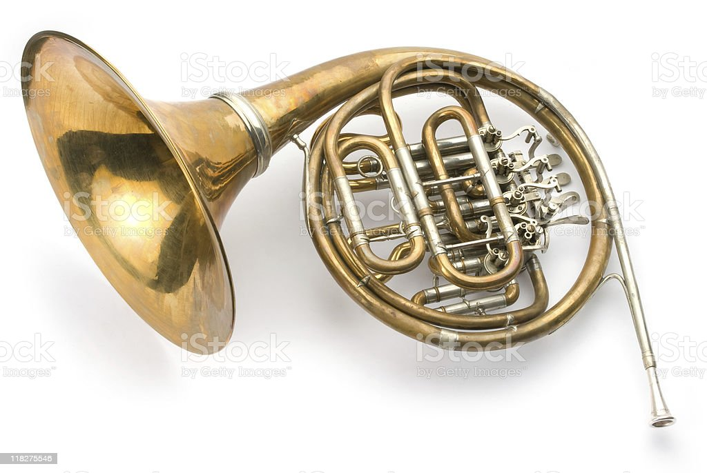 Dull brass French horn on a white background stock photo