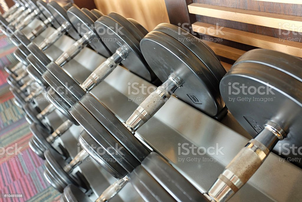 Dumb bells lined up in a fitness studio stock photo