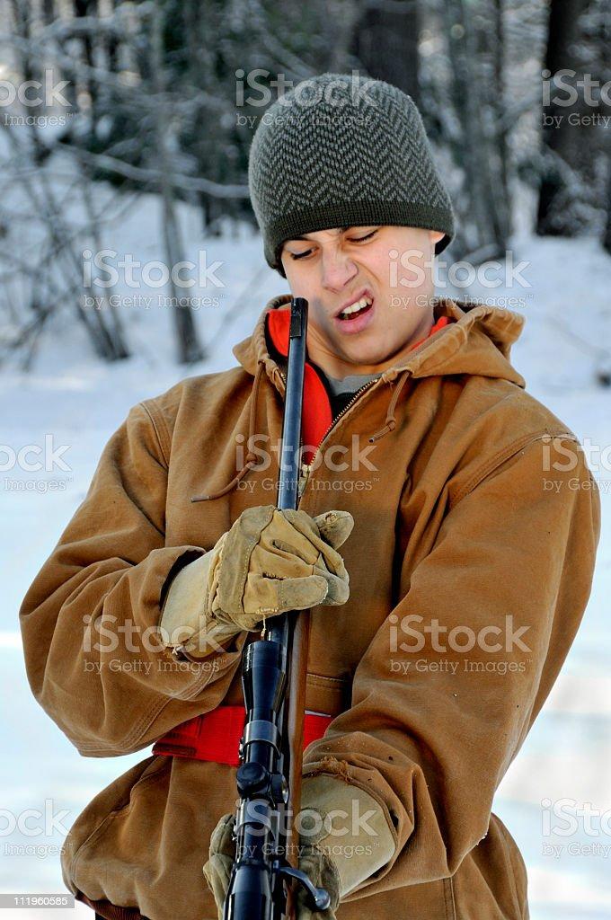 Dumb Hunter Looks Down Barrel stock photo