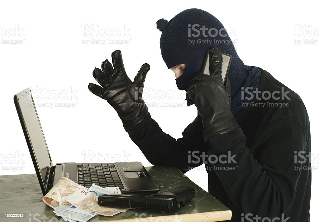 Dumb thief trying to hack into computer stock photo