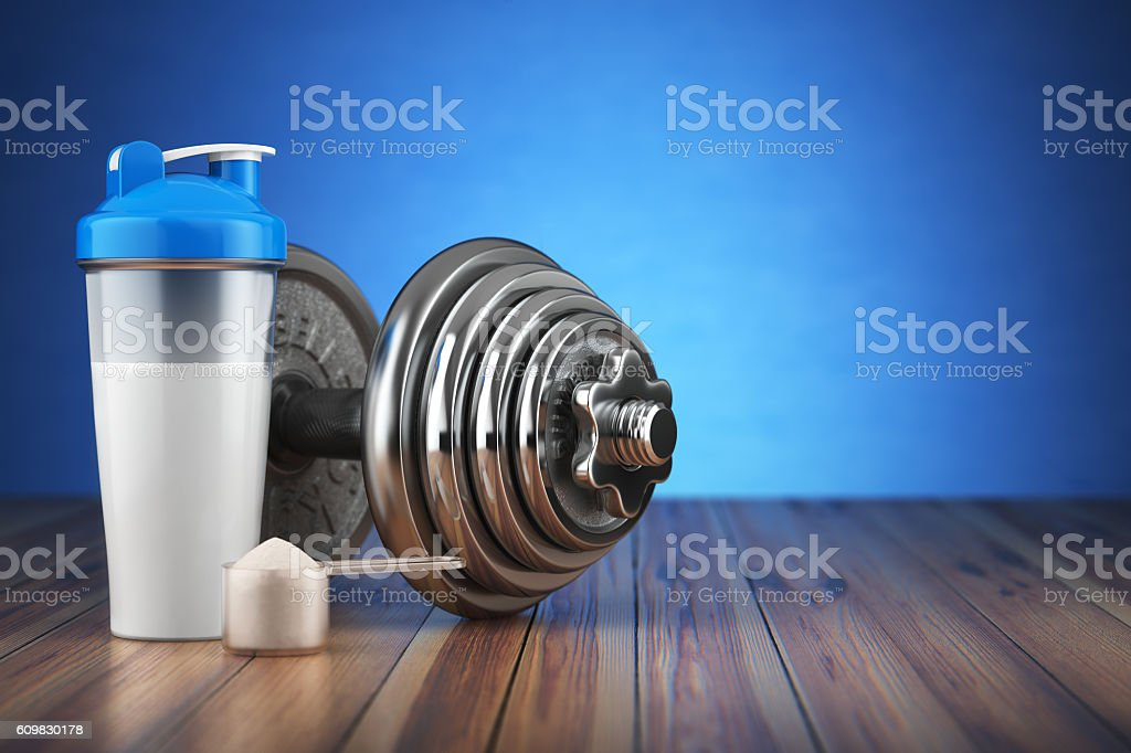 Dumbbell and whey protein shaker. Sports bodybuilding supplement stock photo
