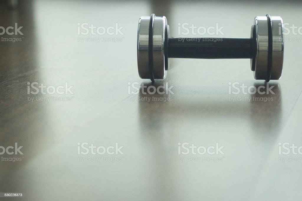 Dumbbell gym metal weights in gym health club stock photo