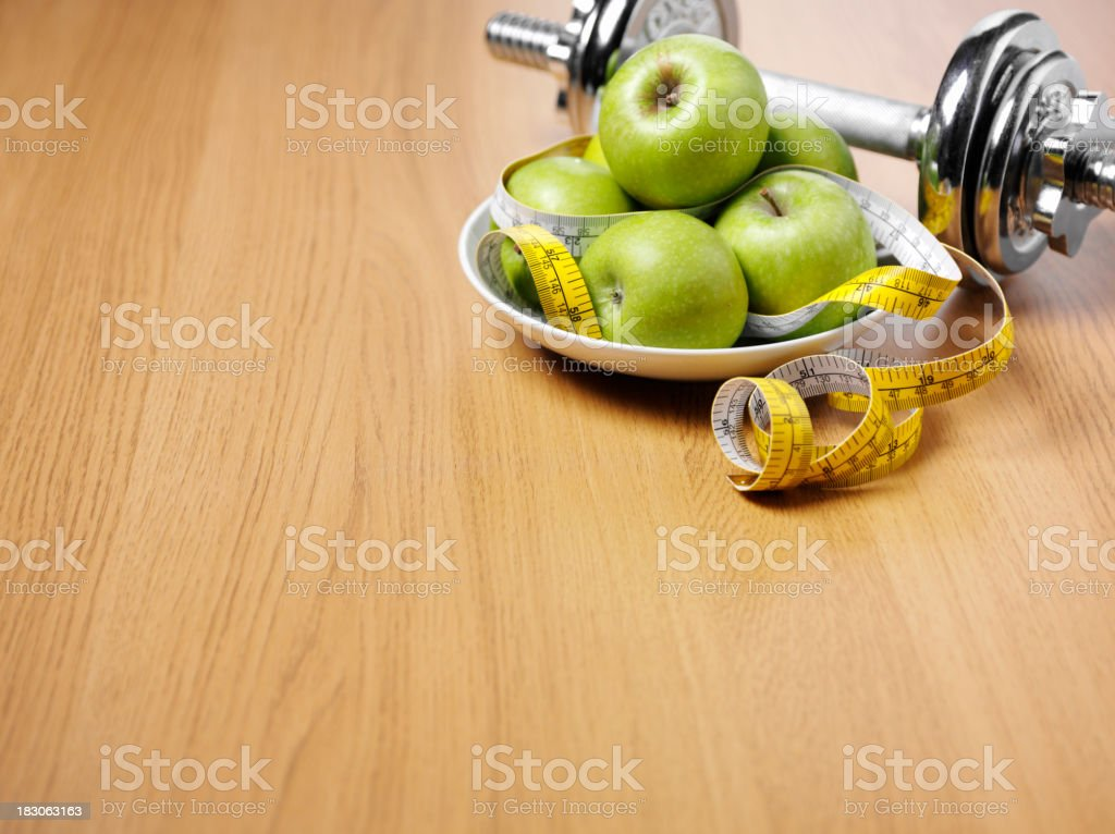 Dumbbell Weights and Apples stock photo