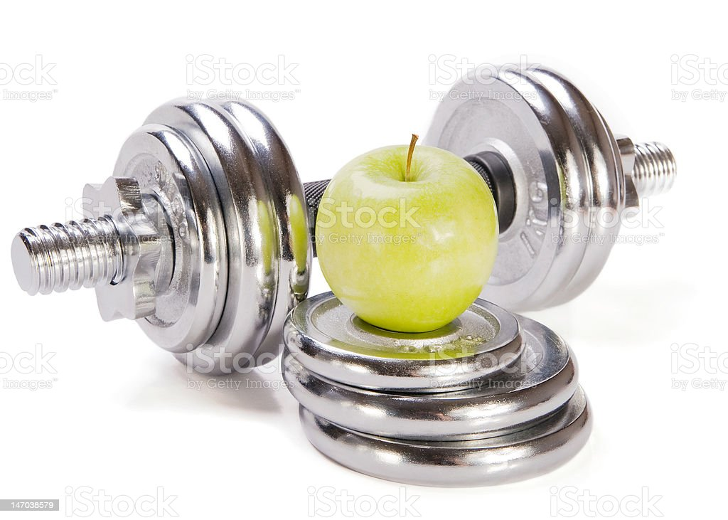 Dumbbells  and green apple royalty-free stock photo