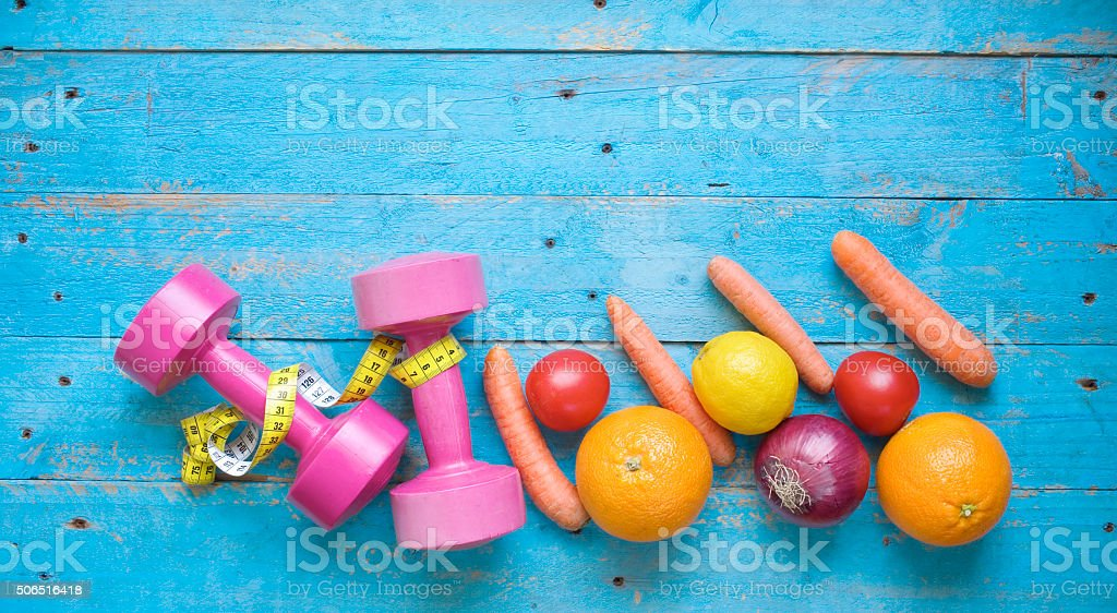 Dumbbells and healthy food stock photo