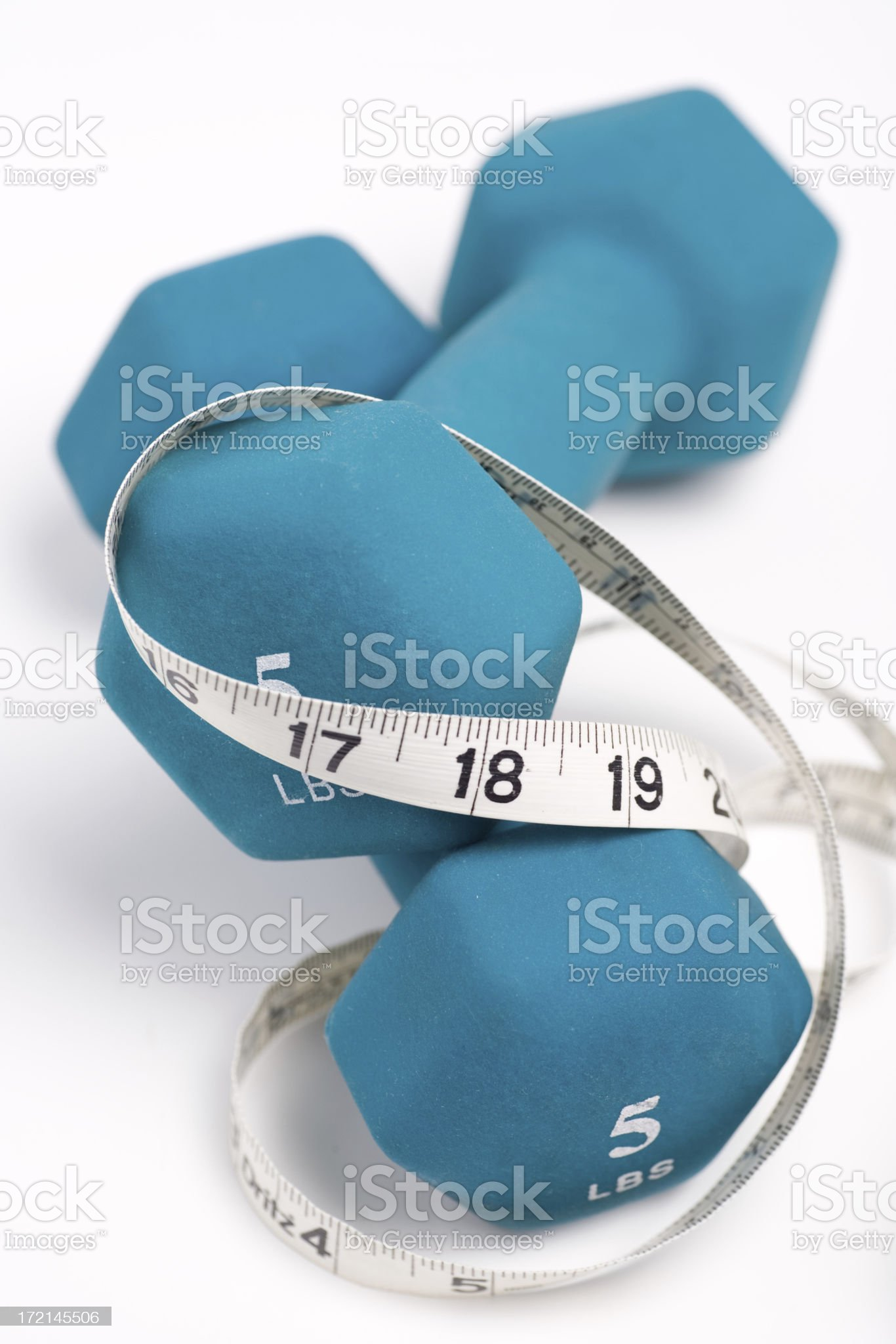 Dumbbells and Measuring Tape royalty-free stock photo