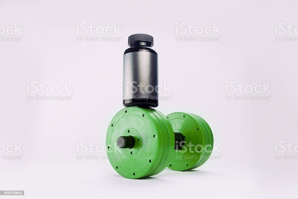 dumbbells and nutritional supplements for bodybuilding stock photo