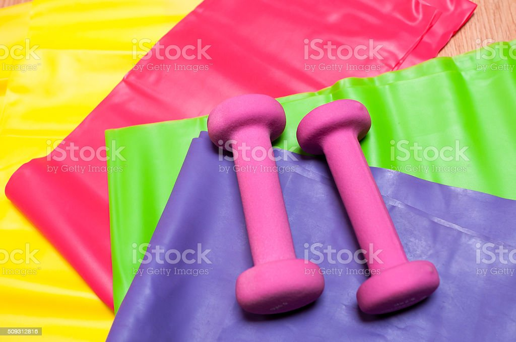 Dumbbells and resistance bands stock photo
