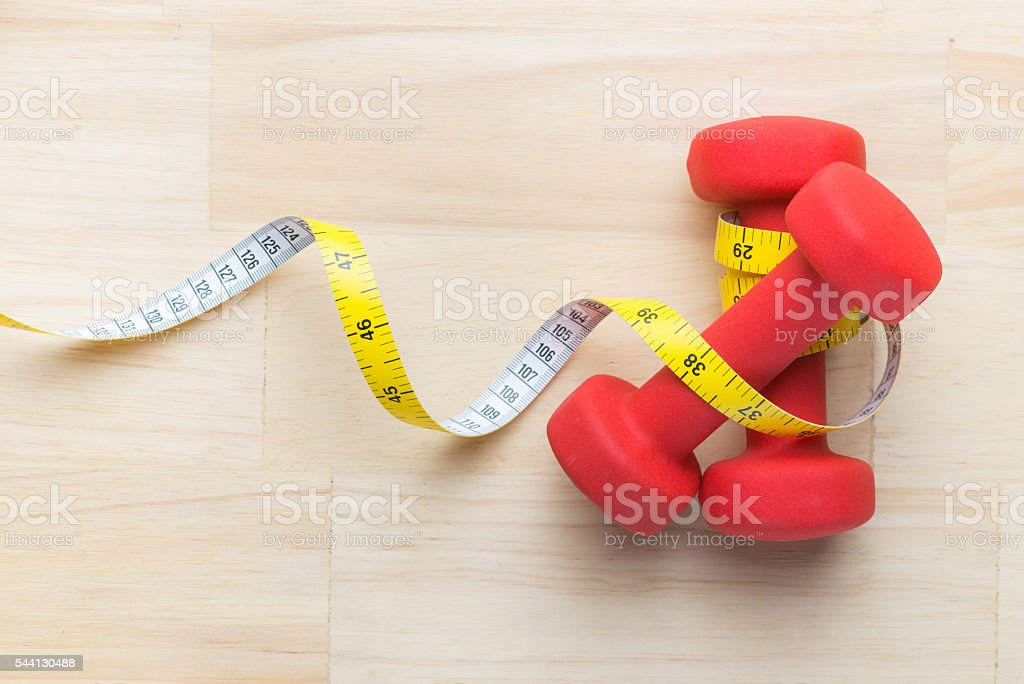 Dumbbells and tape measure stock photo