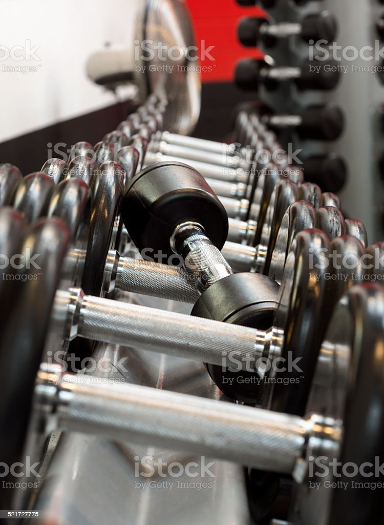 Dumbbells on Weight Rack in Gym stock photo