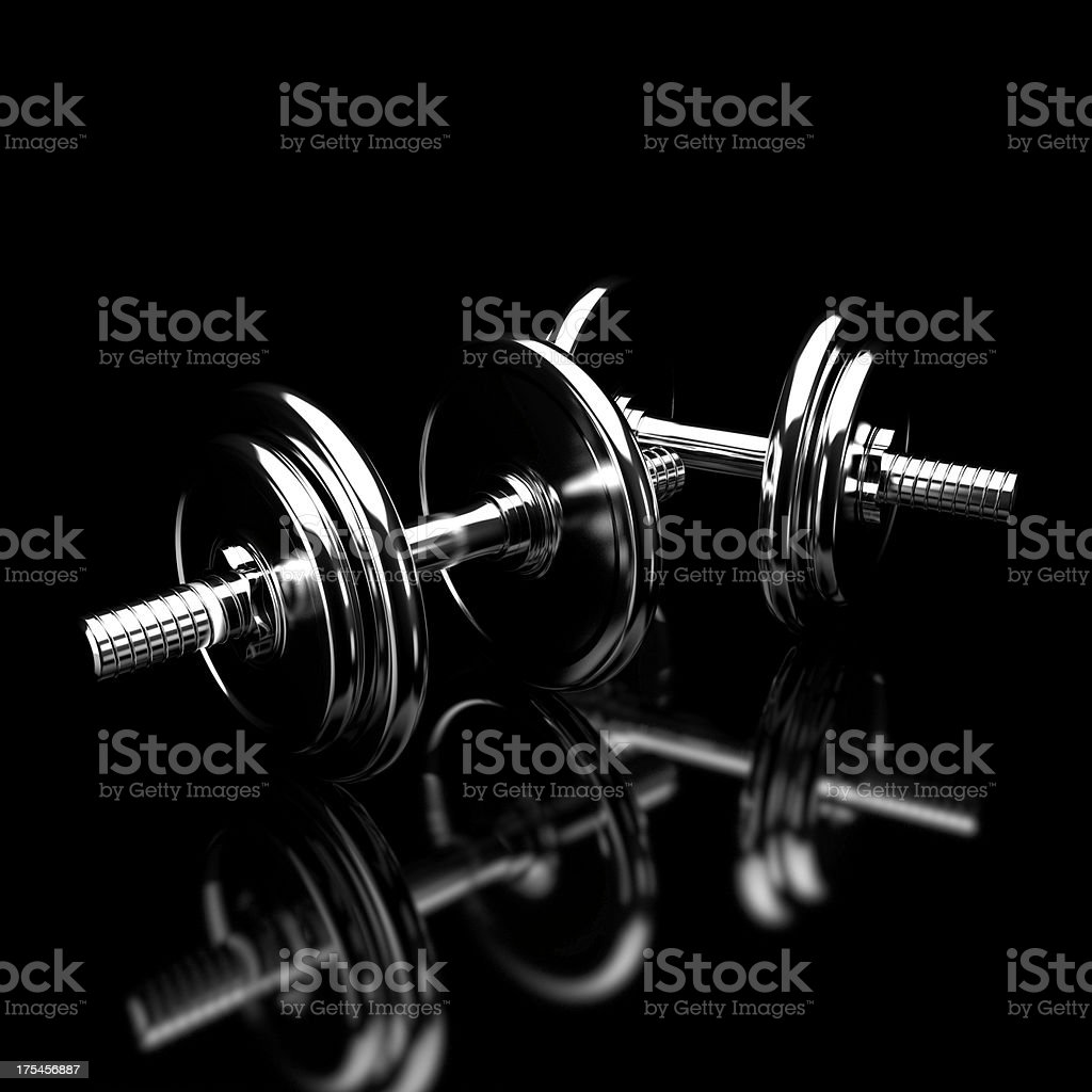 Dumbbells silhouette isolated on black background stock photo