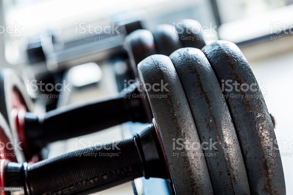 Dumbbells weight training equipment in gym close up stock photo