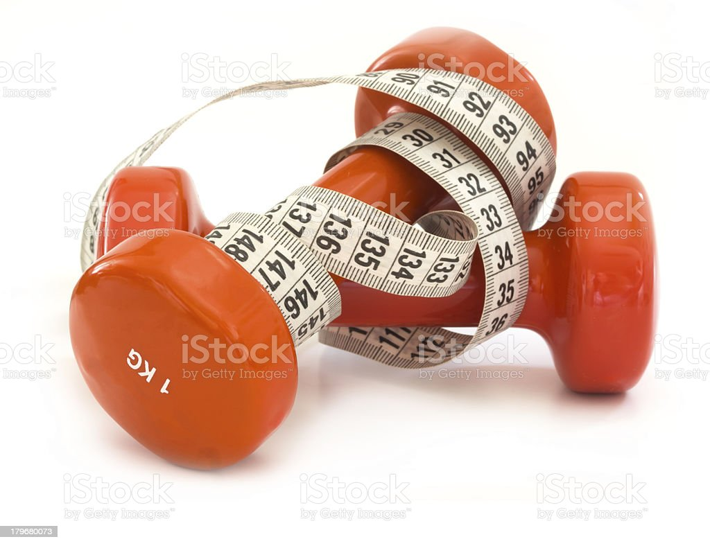 dumbbells with measuring tape isolated royalty-free stock photo