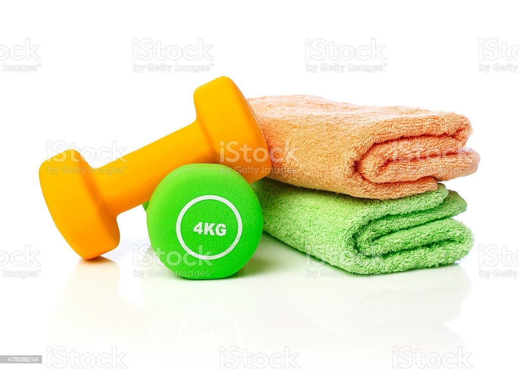Dumbells and towels stock photo