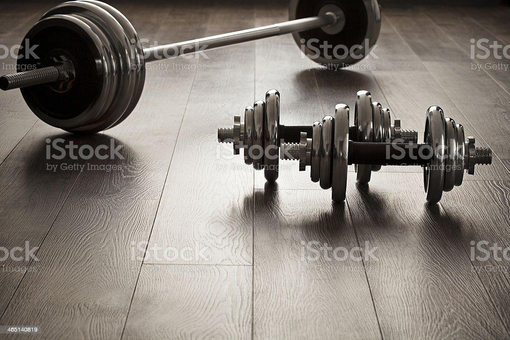 dumbells for fitness on wooden floor stock photo