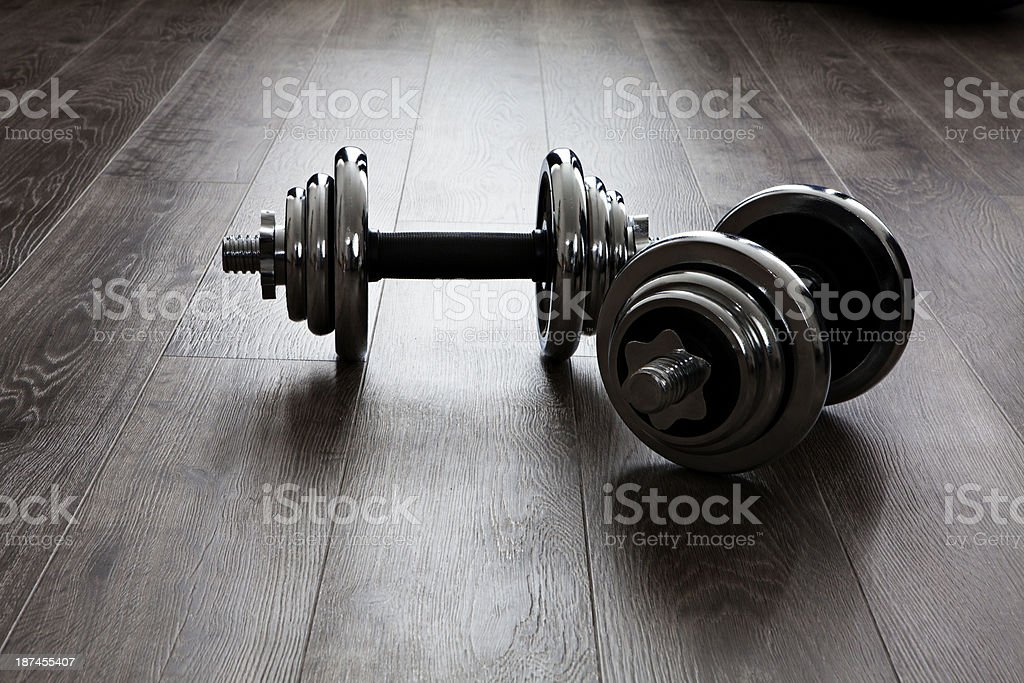 dumbells on wooden floor stock photo
