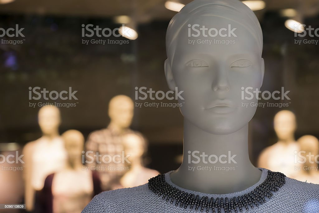 Dummies behind glass of a show-window of boutique stock photo