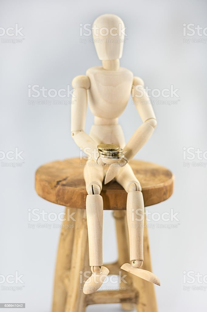 Dummy with coins in its hands stock photo