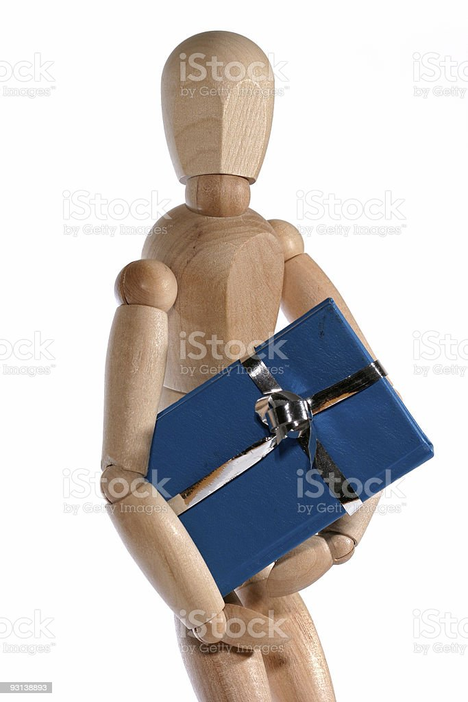 Dummy with present royalty-free stock photo