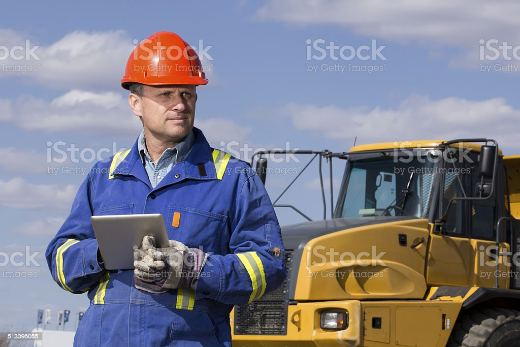 Dump Truck Driver and Tablet Computer stock photo