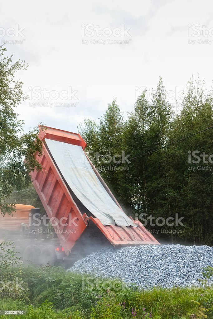 Dump truck dumping gravel stock photo