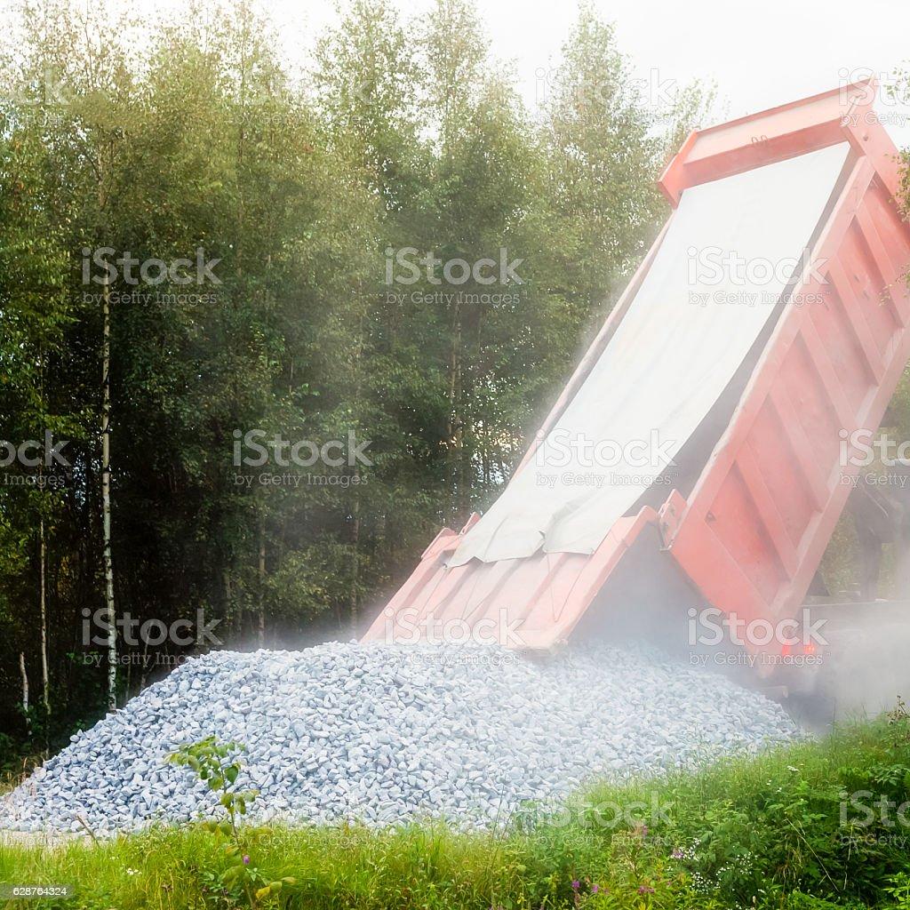 Dump truck dumping gravel stock photo