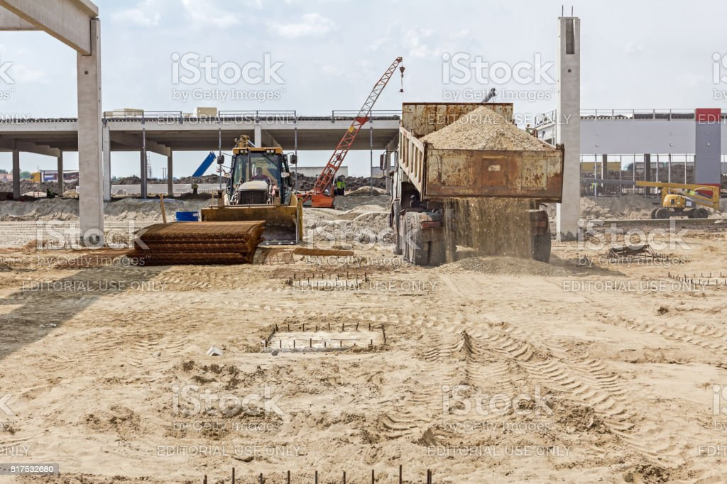 Dump truck is unloading soil. stock photo