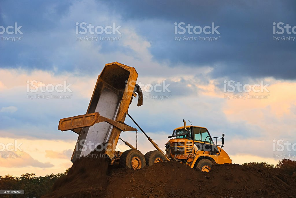 Dump truck loads from earth stock photo