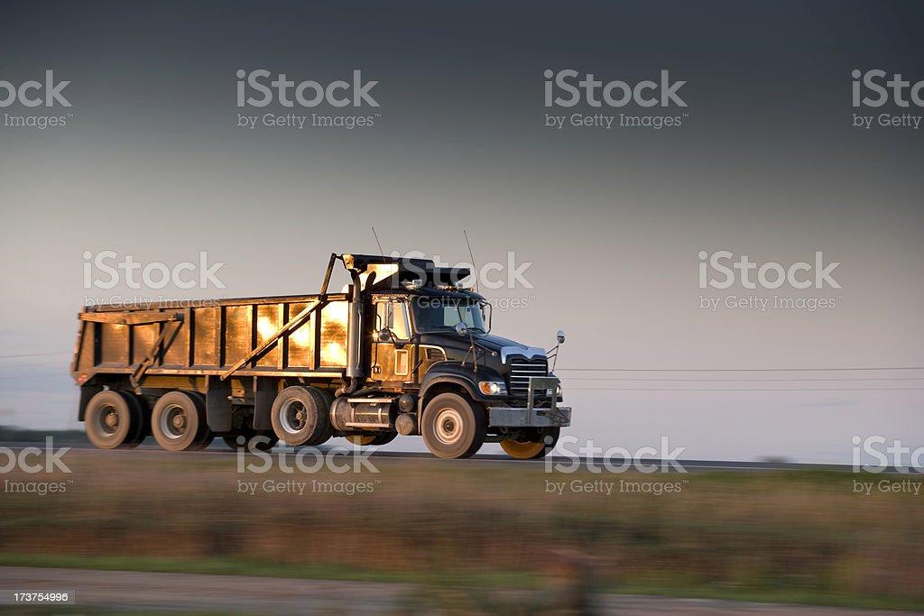 Dump truck speeds down the highway stock photo