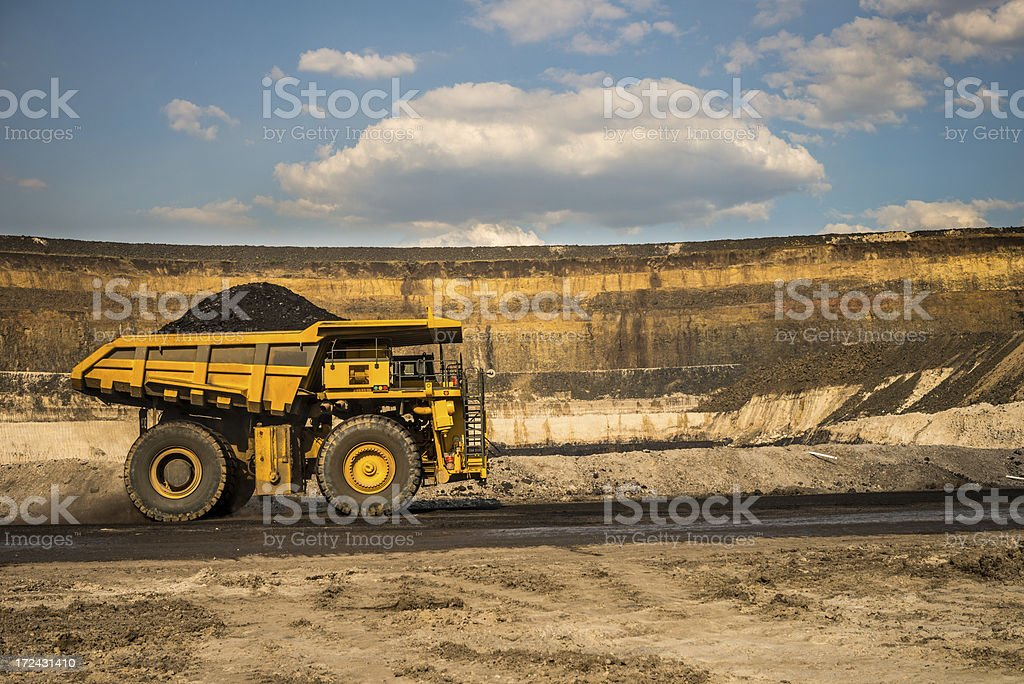 Dump Truck with Coal on a Haul Road stock photo